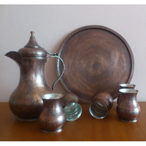 Copper wine service with a set of cups